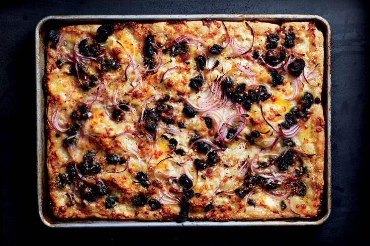 Oil-cured olives are quite salty, and we love their chewy texture, but you can use brined black olives on this pizza if you prefer.