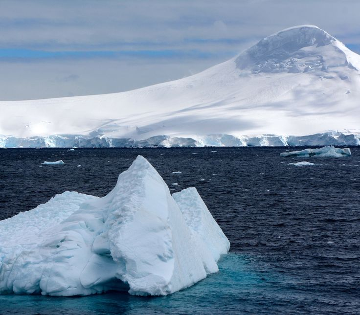 Icebergs and mountains after fresh snow has fallen in Antarctica