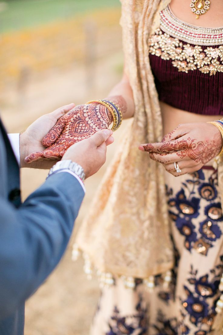 Indian wedding photography. Couple photo shoot ideas. Bridal mehndi or henna designs. Photography: Birds of a Feather