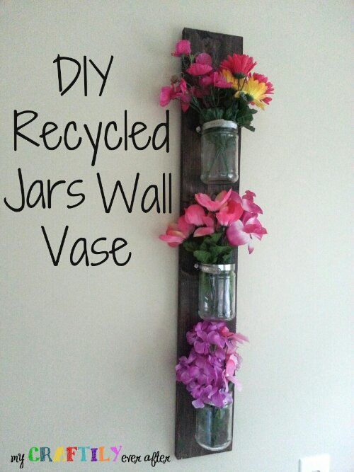 This DIY Recycled Jars Wall Vase would look cute on either side of the front door
