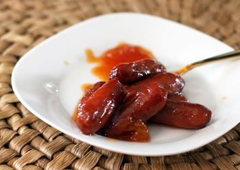 Recipe for little smokies with tangy sauce of grape jelly and chili sauce. An appetizer recipe for little smokies cocktail wieners in the crockpot.