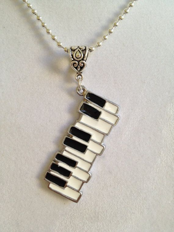 Piano Keyboard Necklace - if this was a brooch, I would definitely consider! It's so cool! SOMEDAY ;00