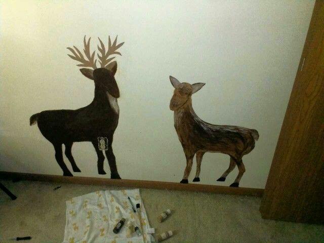 Buck and doe painted in baby boy nursery