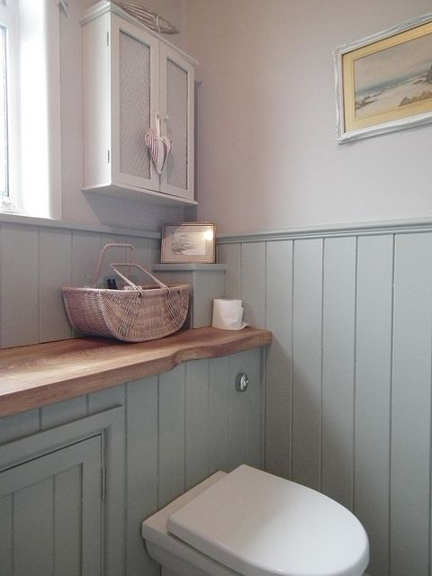 Tongue and groove panelling and white accessories give this toilet room a modern country feel.  If you like this pin, why not head on over to get similar inspiration and join our FREE home design resource library at http://www.TheHomeDesignSchool.com/signup