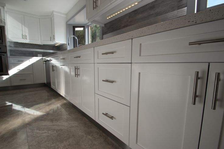 Sleek white shaker cabinets are perfect for modern kitchen remodels.  http://kitchenremodeler-la.com/services/modern-kitchen/ | Pinterest | White  shaker ...