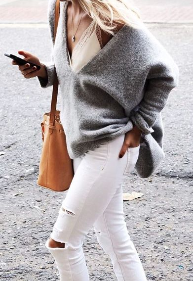 Grey oversized knit sweater, white skinny jeans, tan leather purse