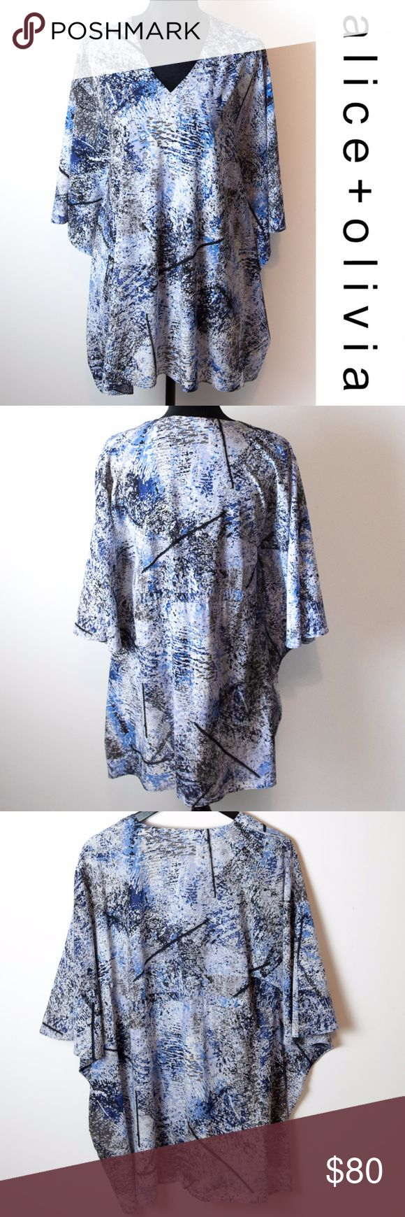Alice + Oliva Blue Graphic Pattern Silk Blouse Sm Alice + Oliva blouse. Size small tunic top with short batwing sleeves. Black, blue, white and gray abstract splatter graphic pattern. V-neck. Silk and spandex blend. Alice + Olivia Tops Blouses