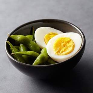 For a protein-packed snack to keep you feeling full, grab a hard-boiled egg and fun-to-eat edamame.