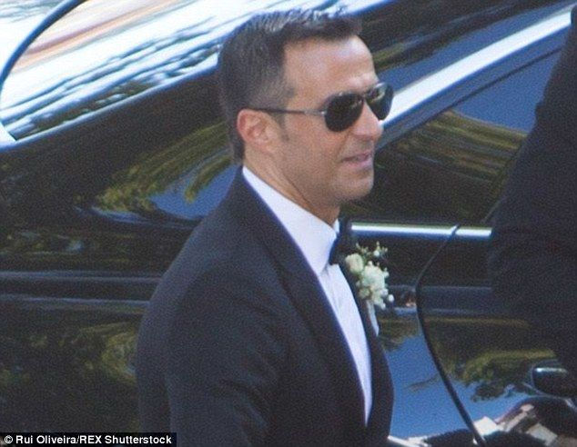 Football super agent Jorge Mendes is all smiles as he arrives at his wedding in Portugal o...