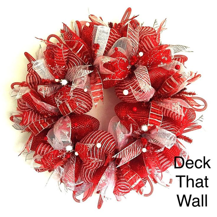 This handmade deco mesh wreath was made with three different colors of deco mesh! Red Premium, White Deluxe, and Red and White Striped Premium perfectly compliment one another! Red and silver wired ri