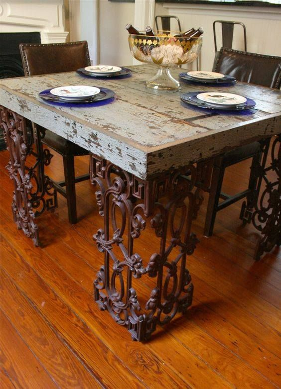 Reclaimed wood and salvaged wrought iron makes a unique table.
