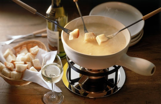 If you're a true cheesehead, take a Swiss vacay to try the fondue and raclette at La Fromagerie in Leysin. (Image credit: © mediacolor's/Alamy) #cheese #retrofoods