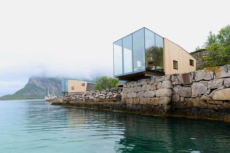 snorre stinessen constructs cantilevered cabins for norwegian island resort