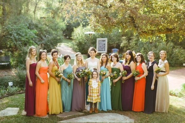 Love these #bridesmaid dresses...the fall colors are amazing! From http://ruffledblog.com/colorful-fort-worth-wedding/  Photo Credit: http://jessbarfield.com/