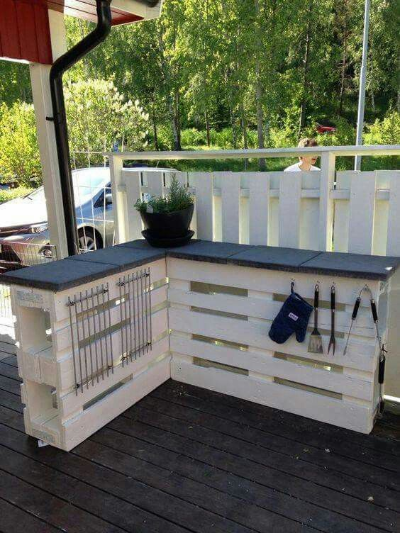 Pallets pained and screwed together to make a BBQ counter for a patio.