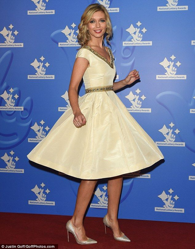 Spinning around:Countdown beauty Rachel Riley wore a twee cream, prom style gown which bo...