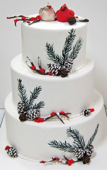 Winter wedding cake, painted pine limbs, red berries, cardinal cake topper, pine