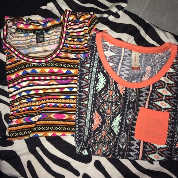 Tribal Shirt bundle 2 tribal print shirts (pretty much NEW) Both size small!  One from rue 21 and the other idk honestly The top one, from rue 21 is a silky shirt and the other is cotton! *no trades* Rue 21 Tops Tees - Short Sleeve