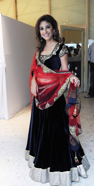 Vikram Phadnis- velvet, black, and red