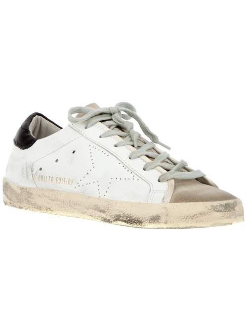 White leather trainers from Golden Goose featuring a round closed toe, top lace fastenings, a cream sole, a blue detail on heel and a star detail on side.