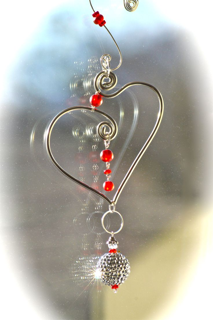 """New Sun-Catcher. Beautiful silver wire heart shaped suncatcher is ready to hang in a garden, window or anywhere in the home of the one you love. 9""""-4"""" Make valentine's a sparkly day. To purchase email us at coirnini@gmail.com"""