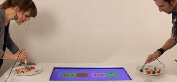 Una mesa videojuego que da puntos por comer