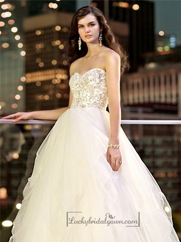 With a gorgeous beaded bodice and a flowy tulle skirt, this designer ball gown is sure to make a statement. Features a sparkling encrusted crystal adorned bodice, sweetheart neckline, and a full skirt that flares out from the natural waist.
