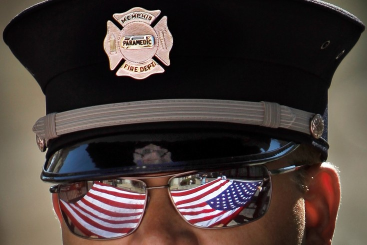 Memphis firefighter David Schlauch helps refold a giant American flag after the annual September 11 Fire Services Memorial at the Museum, New York - awesome picture