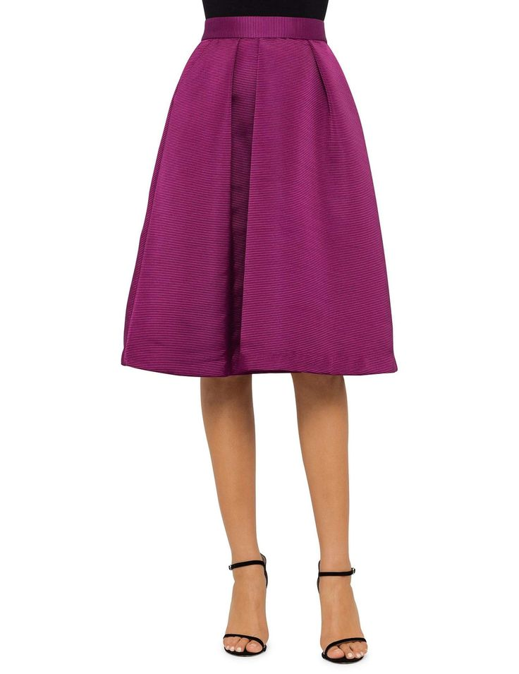 Ted Baker -  Bold and feminine, this statement high rise midi skirt brings instant elegance to any outfit. The sporty high shine ribbed fabric is contrasted by the flirty full pleats in the front and back that create volume and dimension with every step.