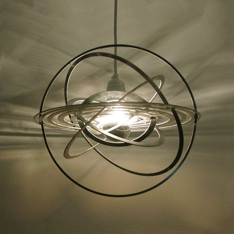 Inspired By The Orbiting Planets Of Our Solar System, This Playful Ceiling  Lamp Creates Interesting Shadows On The Walls And Ceilings.