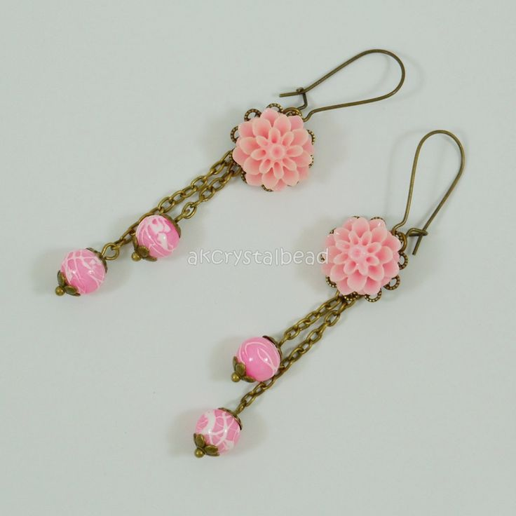 Pink flower cabochon and pink glass bead earrings. PRP0031
