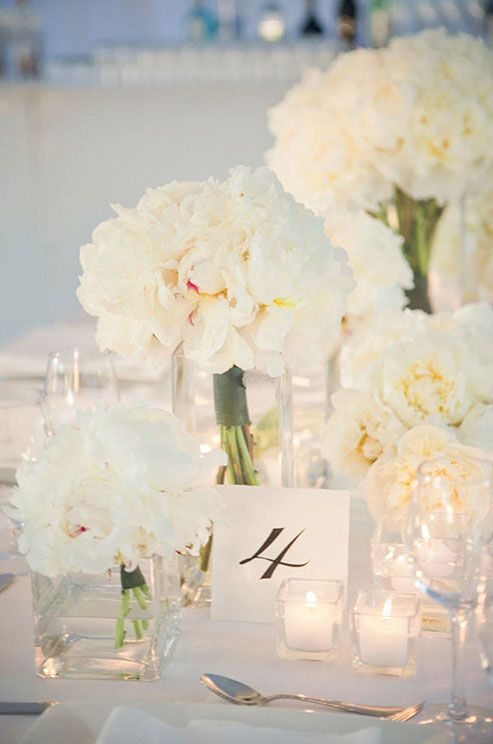 These lush and sophisticated white peony arrangements are the perfect combination of chic and romantic. #weddingcenterpeice