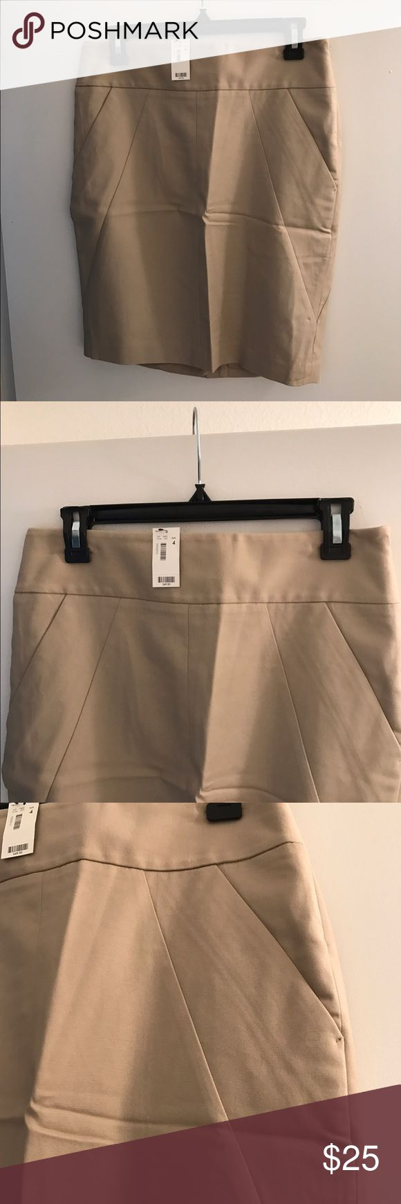 Khaki pencil skirt from The Limited, NWT. Khaki pencil from The Limited. Great basic with a few feminine pleats to highlight curves. No pockets for a smooth look. Lined. Size 4. Waist 15 inches, hips 18, bottom 17, length 21. New with tags. Outshell 98% cotton, 2% spandex, lining 100% poly. Smoke free home. The Limited Skirts Pencil
