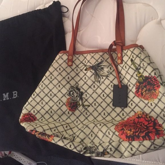 Gwen Stefani L.A.M.B handbag Beautiful summer bag, off white color with orangey flowers... Super feminine and in great condition. No major signs of wear. Inside totally clean. The lamb tag is attached by a leather loop and one of the connections is torn. Can easily be repaired or tag can just be taken off. L.A.M.B. Bags Shoulder Bags