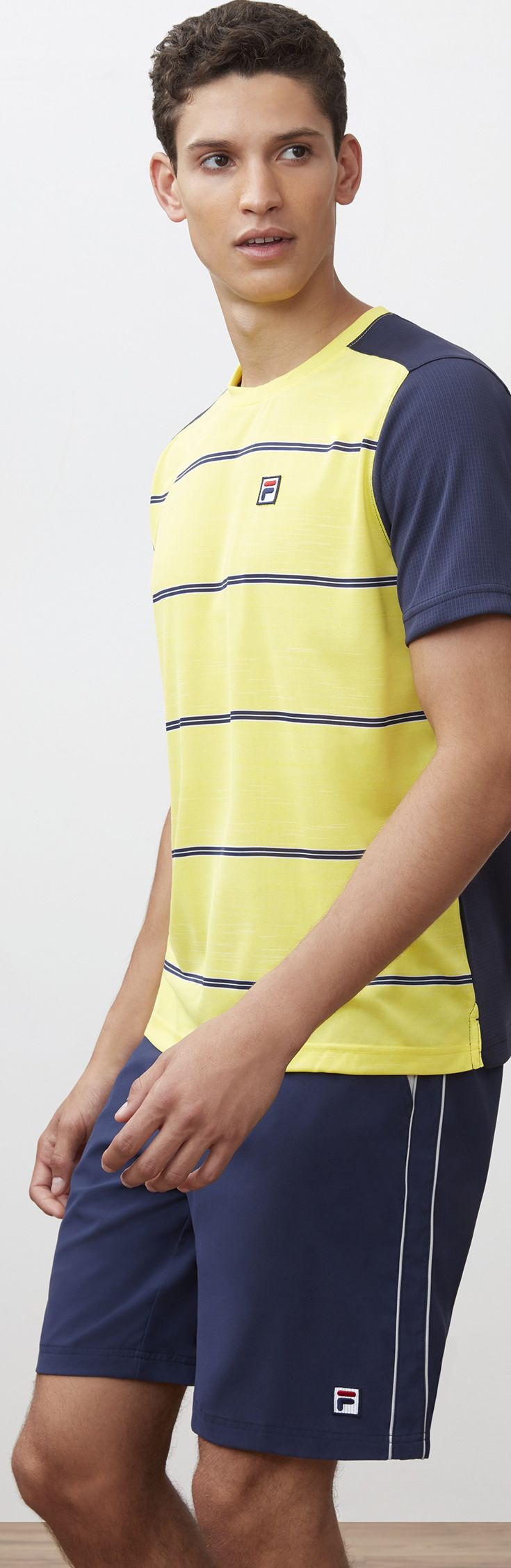 Check out the newest Fila men's Legend Collection of premium tennis apparel for spring 2018 at MidwestSports.com. This tennis line includes performance tennis shirts, polos, shorts, and warm ups in navy, yellow, and grey colors perfect for the tennis season.