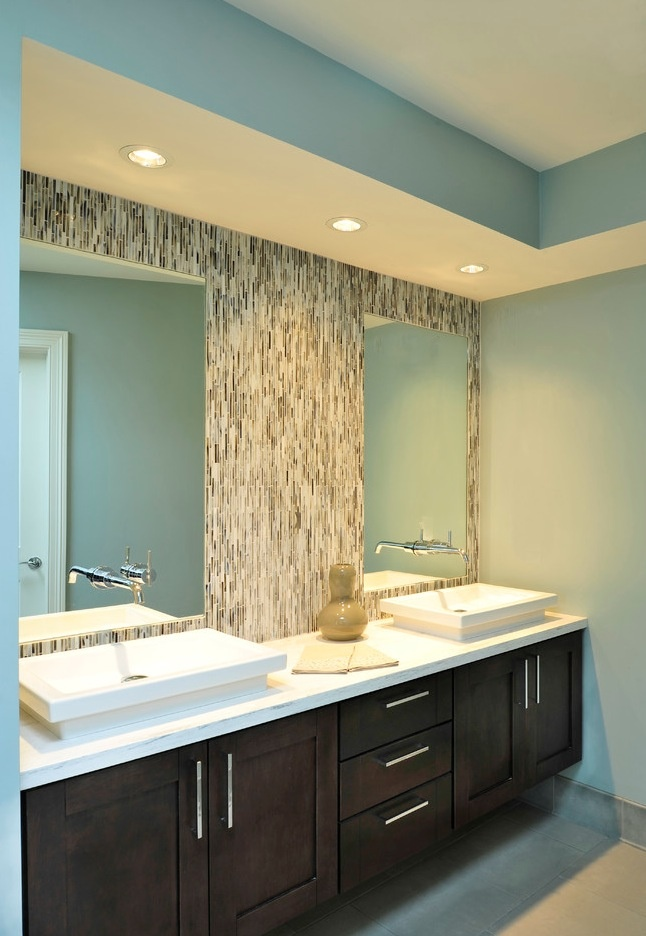 Nice tile backsplash. Rectangular low-rise basins. Cabinets (though might prefer either to-floor cabinets or a higher floating one)