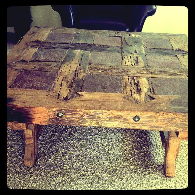 Rustic table made of rail road ties .