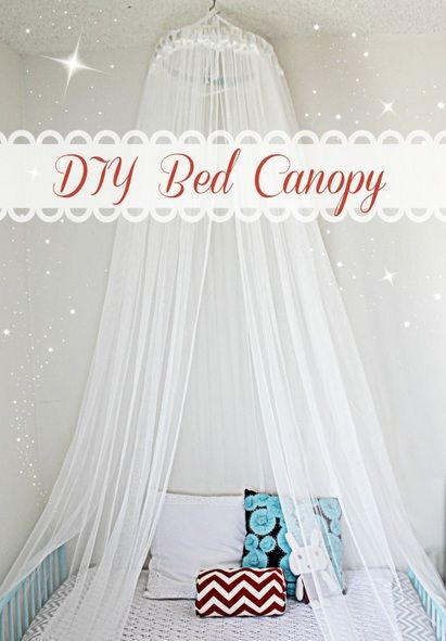 How to make a Bed Canopy  Supplies:  - 1 large embroidery hoop (I found mine at the thrift store for $1). - sheer curtains, or any fabric or tulle that strikes your fancy (mine were from the As-is section at Ikea for just .99 cents). - 1 ceiling screw hook (I got it at my local hardware store for less then a $1, as well). - coordinating ribbon.