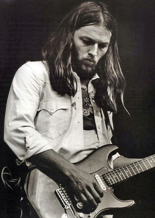 David Gilmour.  Not overly flashy, but his tone and taste are astounding.  Someone who plays solos that you remember note for note in your head decades later is a true master!