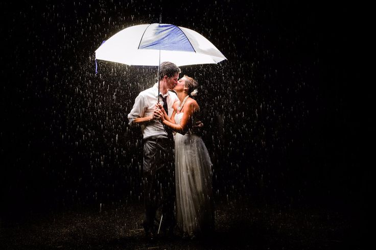 Wedding in the rain! No amount of rain can dampen the love in a moment like this!
