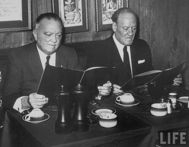 FBI director J. Edgar Hoover and his assistant Clyde Tolson looking at menus in the Mayflower Hotel where they lunched together each workday for 40 years, Washington, DC, 1970