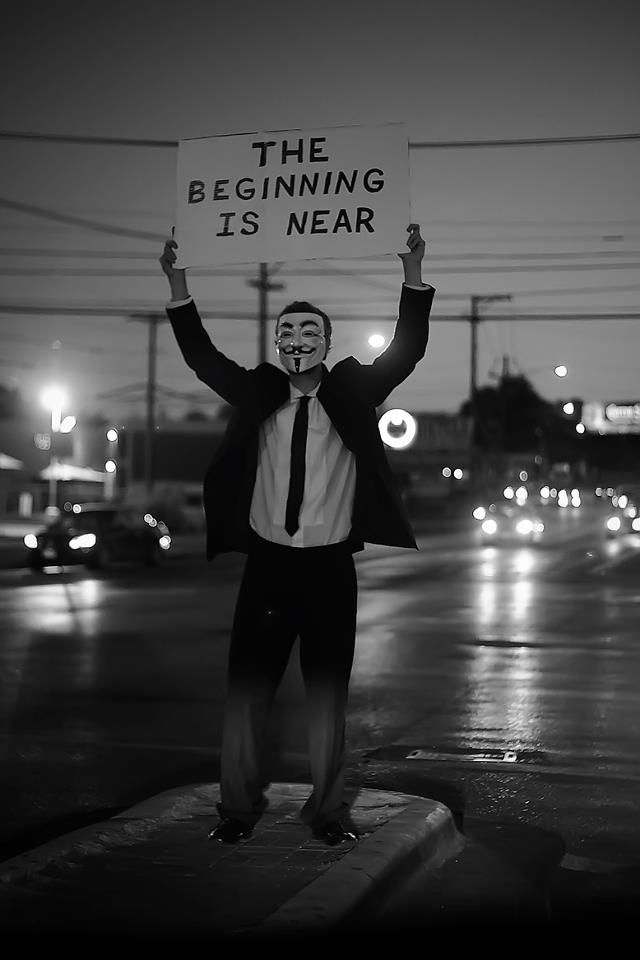 A sign being held by a member of the activist group 'Anonymous'.