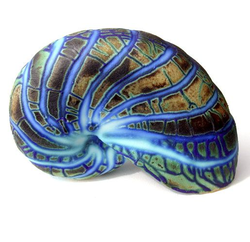 Small Shell  Dimensions: 15cm (6in) long approx  Material: Porcelain Firing Temperature: 1200 deg. c  Glaze: Barium based .   Pauline's Gallery