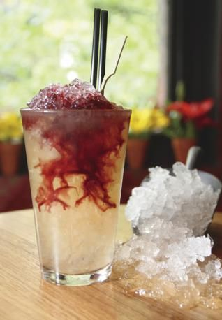 Jamaican Kool-Aid - *2 oz Light Rum  *2/3 oz Apple Liqueur  *1/3 oz Limoncello  *1 oz Port  *Grapefruit Soda   - Combine your rum, apple liqueur and Limoncello into a highball glass. Fill with crushed ice and then top off with a splash of grapefruit soda, followed by your port for an awesome look (like in the photo).