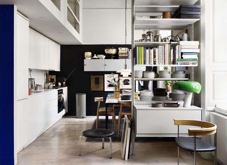 Kitchen with a bookshelf and dining area with storage