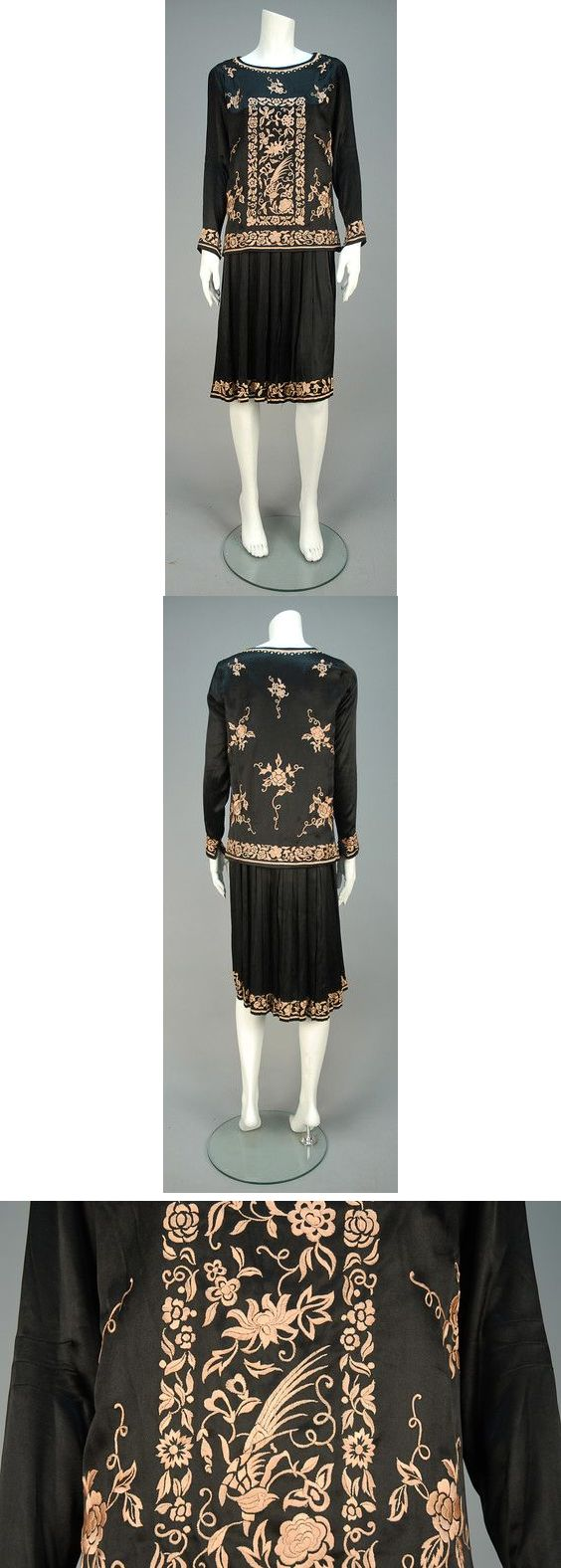 Day dress, 1920s. 2-piece black silk having tunic embroidered in a pale pink Orientalist floral with birds, long sleeve with five self buttons at cuff, worn over a sleeveless dress with pleated skirt embroidered at hem. B-36, low W-38, L-42. $330