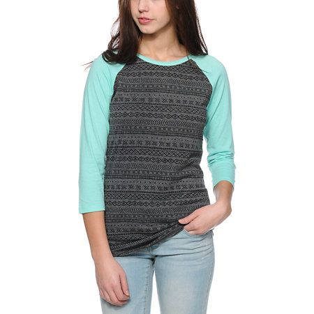 A Charcoal and Black burnout tribal print body is contrasted by Mint raglan sleeves in the Empyre Georgina baseball tee shirt for women. Made with a lightweight and soft cotton poly blended construction for comfort, this baseball tee shirt is a long slim