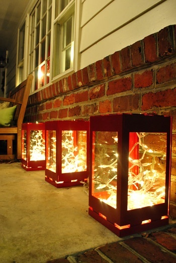 Pretty little red lanterns with small strand of white lights in each. A lovely lit porch idea for Christmas. christmas