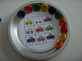 Fun for traveling kids.... Use a pie plate, with magnetic buttons and double sided magnetic car games like this car bingo. Other games she used for this are signs to look for on the road.