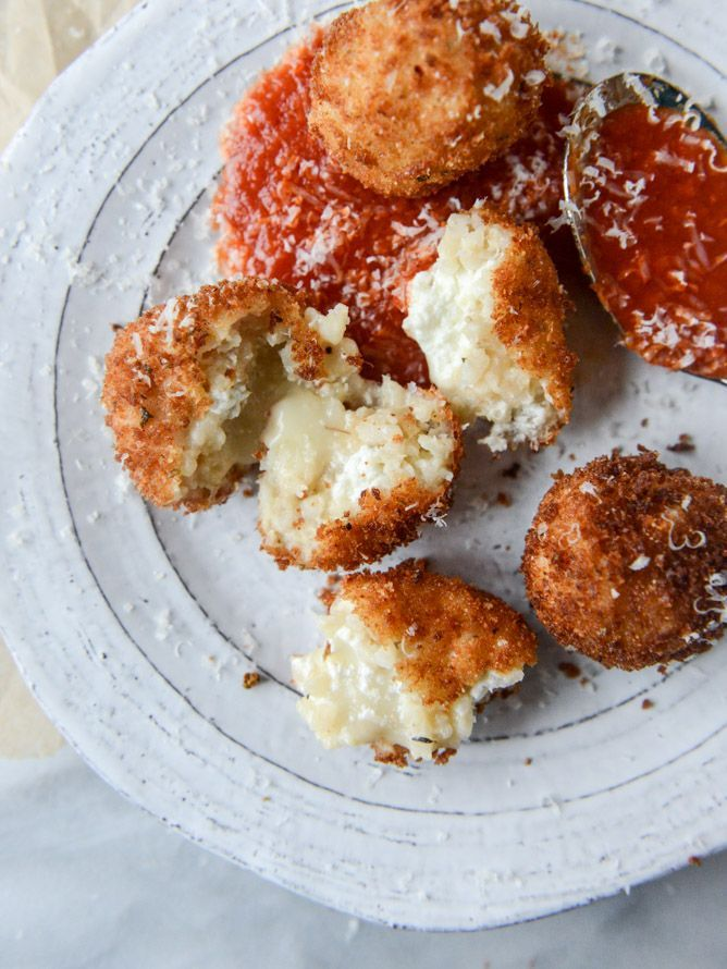 fontina, roasted garlic and goat cheese arancini from @howsweeteats